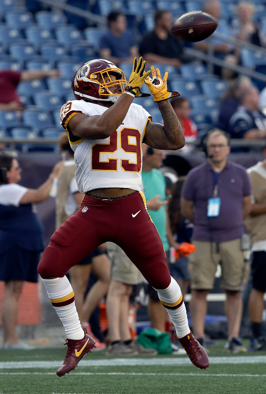 . Washington Redskins running back Derrius Guice warms up before a preseason NFL football game against the New England Patriots, Thursday, Aug. 9, 2018, in Foxborough, Mass. (AP Photo/Charles Krupa)