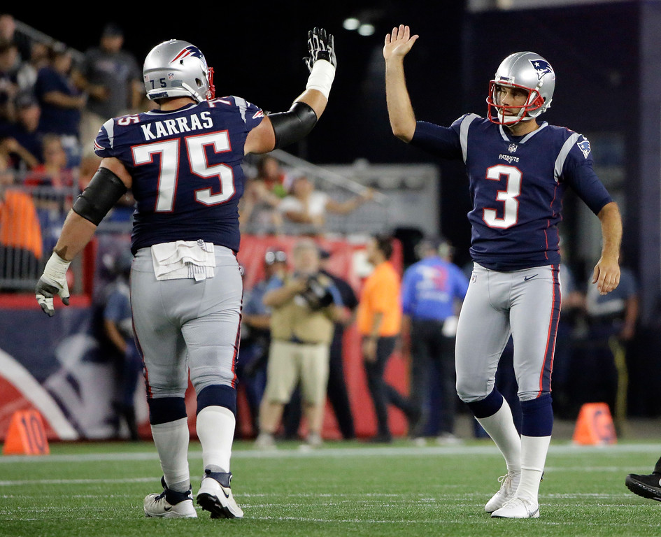 . New England Patriots guard Ted Karras (75) congratulates kicker Stephen Gostkowski (3) after a field goal during the first half of a preseason NFL football game against the Washington Redskins, Thursday, Aug. 9, 2018, in Foxborough, Mass. (AP Photo/Steven Senne)