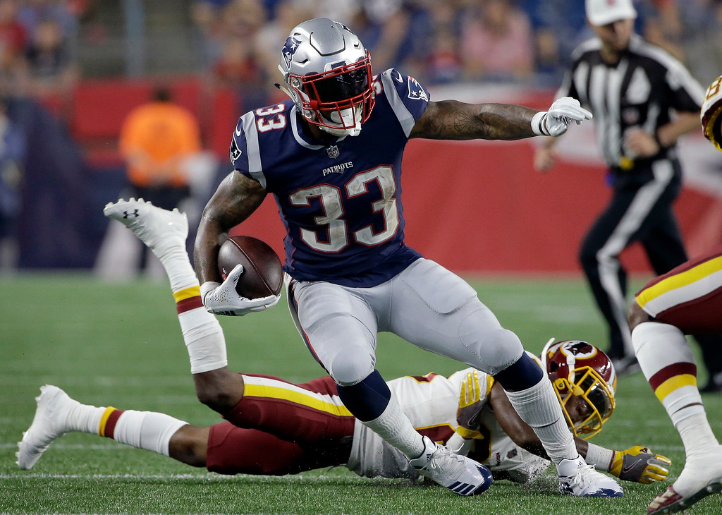 . New England Patriots running back Jeremy Hill (33) gains yardage against the Washington Redskins during the second half of a preseason NFL football game, Thursday, Aug. 9, 2018, in Foxborough, Mass. (AP Photo/Steven Senne)