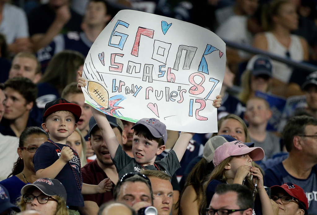 . A young fan holds a signe during the first half of a preseason NFL football game between the New England Patriots and the Washington Redskins, Thursday, Aug. 9, 2018, in Foxborough, Mass. (AP Photo/Steven Senne)