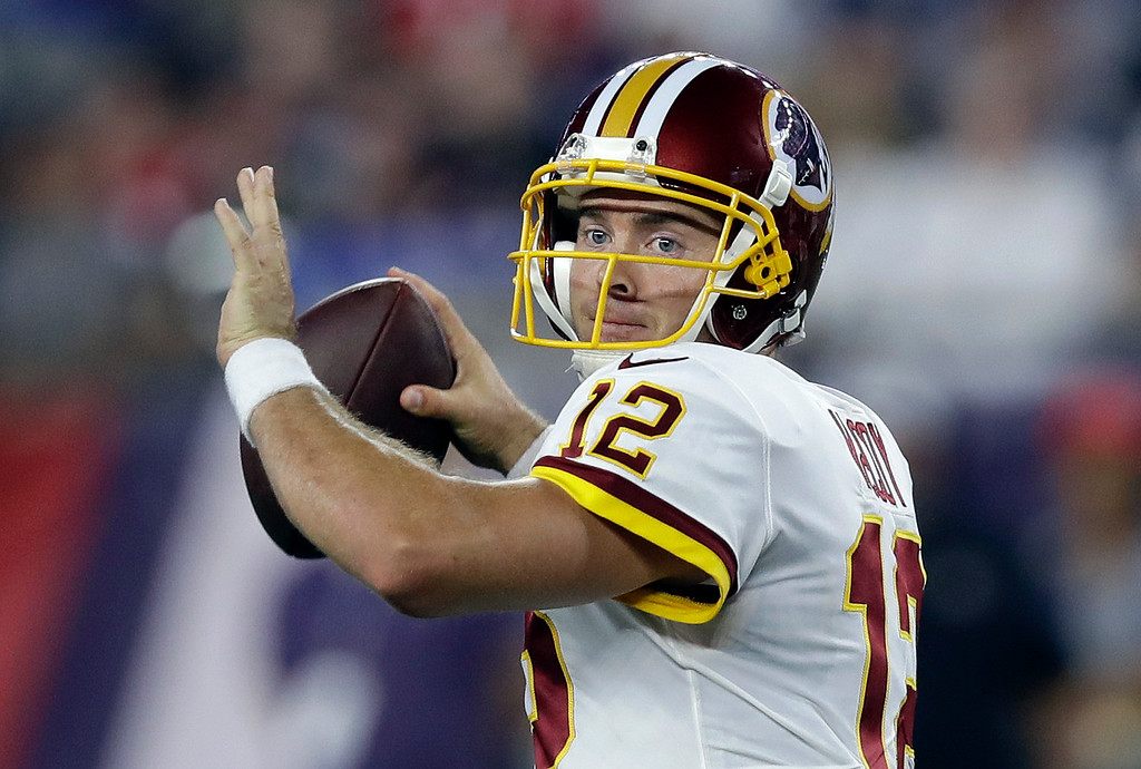 . Washington Redskins quarterback Colt McCoy passes against the New England Patriots during the first half of a preseason NFL football game, Thursday, Aug. 9, 2018, in Foxborough, Mass. (AP Photo/Charles Krupa)