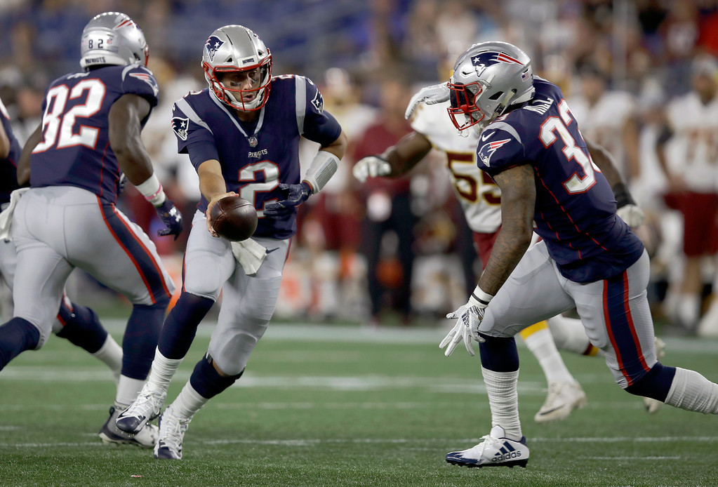 . New England Patriots quarterback Brian Hoyer (2) hands off to running back Jeremy Hill during the second half of a preseason NFL football game against the Washington Redskins, Thursday, Aug. 9, 2018, in Foxborough, Mass. (AP Photo/Charles Krupa)