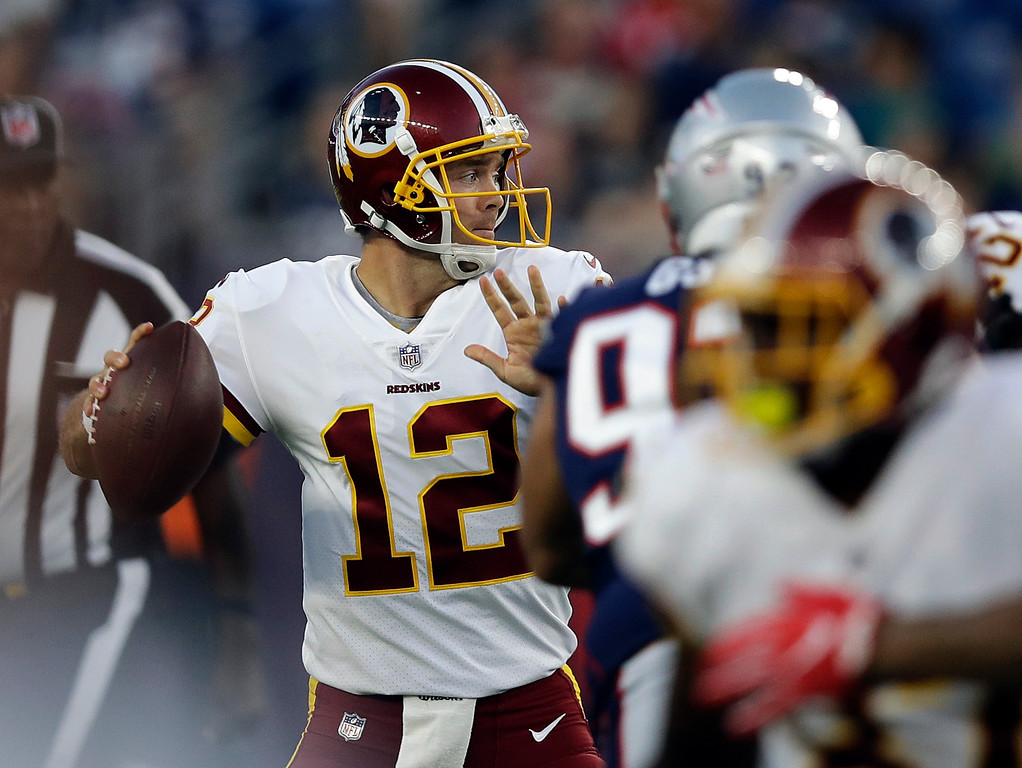 . Washington Redskins quarterback Colt McCoy (12) looks for a receiver against the New England Patriots during the first half of a preseason NFL football game, Thursday, Aug. 9, 2018, in Foxborough, Mass. (AP Photo/Charles Krupa)