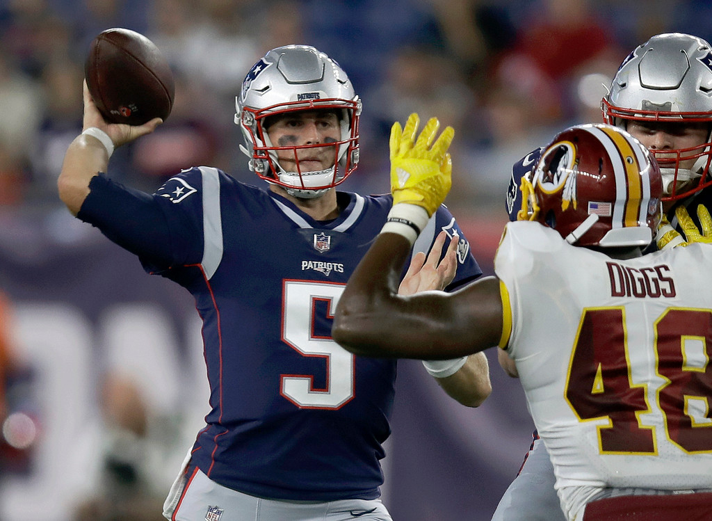 . New England Patriots quarterback Danny Etling (5) passes under pressure from Washington Redskins linebacker Vontae Diggs (48) during the second half of a preseason NFL football game, Thursday, Aug. 9, 2018, in Foxborough, Mass. (AP Photo/Charles Krupa)