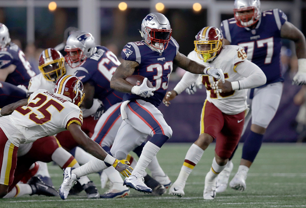 . New England Patriots running back Jeremy Hill (33) gains yardage against the Washington Redskins during the first half of a preseason NFL football game, Thursday, Aug. 9, 2018, in Foxborough, Mass. (AP Photo/Charles Krupa)