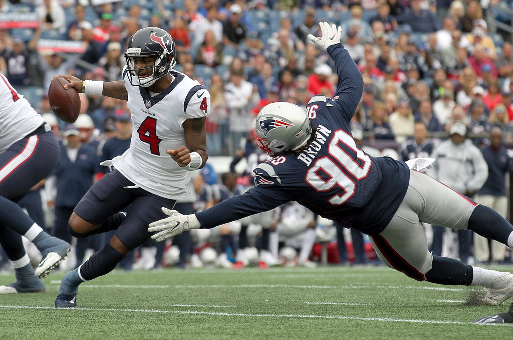 . New England Patriots defensive tackle Malcom Brown (90) pursues Houston Texans quarterback Deshaun Watson (4) during the second half of an NFL football game, Sunday, Sept. 9, 2018, in Foxborough, Mass. (AP Photo/Stew Milne)