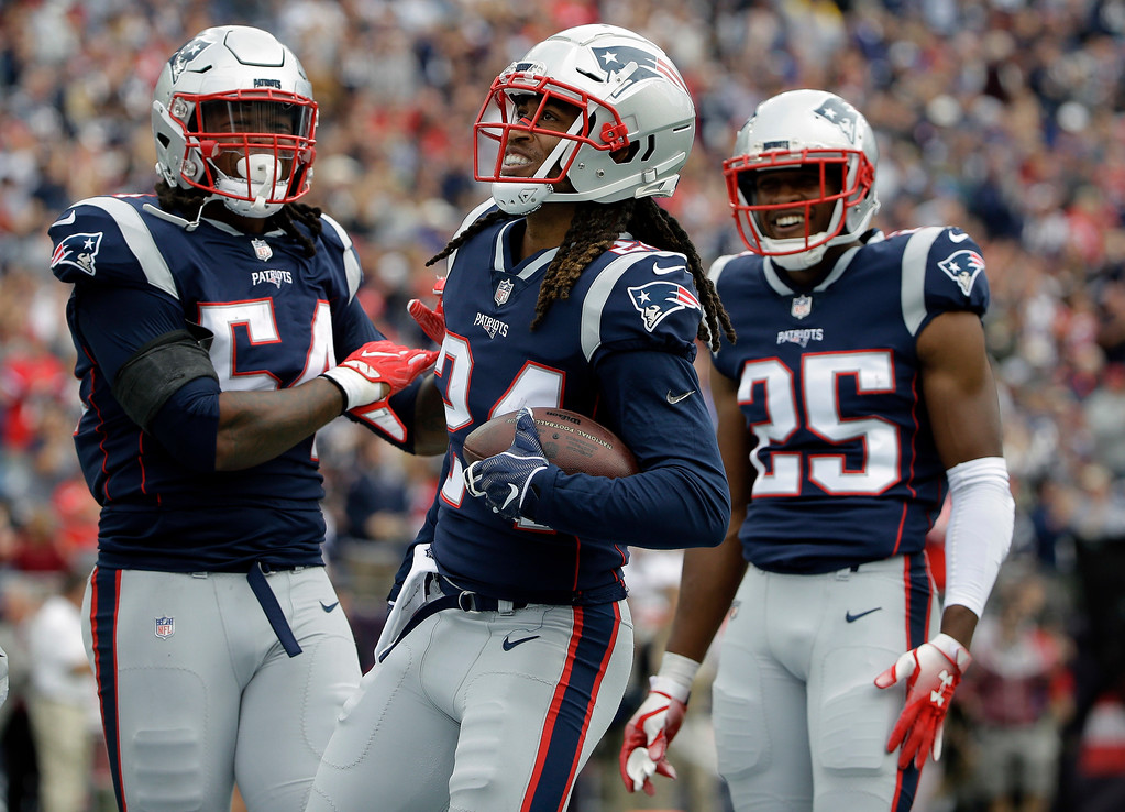 . New England Patriots defensive back Stephon Gilmore, center, celebrates his interception with Dont\'a Hightower, left, and Eric Rowe, right, during the first half of an NFL football game against the Houston Texans, Sunday, Sept. 9, 2018, in Foxborough, Mass. (AP Photo/Steven Senne)