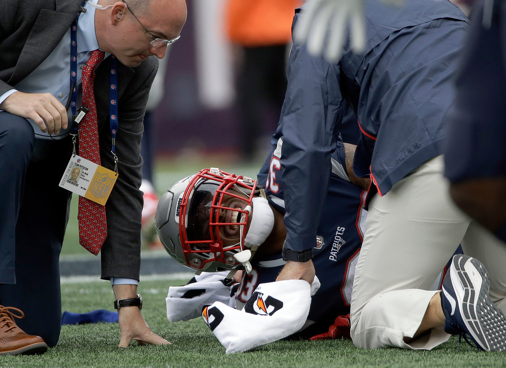 . New England Patriots running back Jeremy Hill receives attention on the field after an injury during the second half of an NFL football game against the Houston Texans, Sunday, Sept. 9, 2018, in Foxborough, Mass. (AP Photo/Steven Senne)