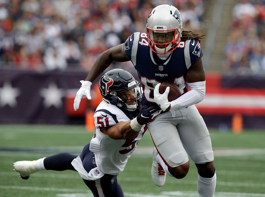 . New England Patriots wide receiver Cordarrelle Patterson (84) eludes Houston Texans linebacker Dylan Cole (51) after catching a pass during the second half of an NFL football game, Sunday, Sept. 9, 2018, in Foxborough, Mass. (AP Photo/Charles Krupa)
