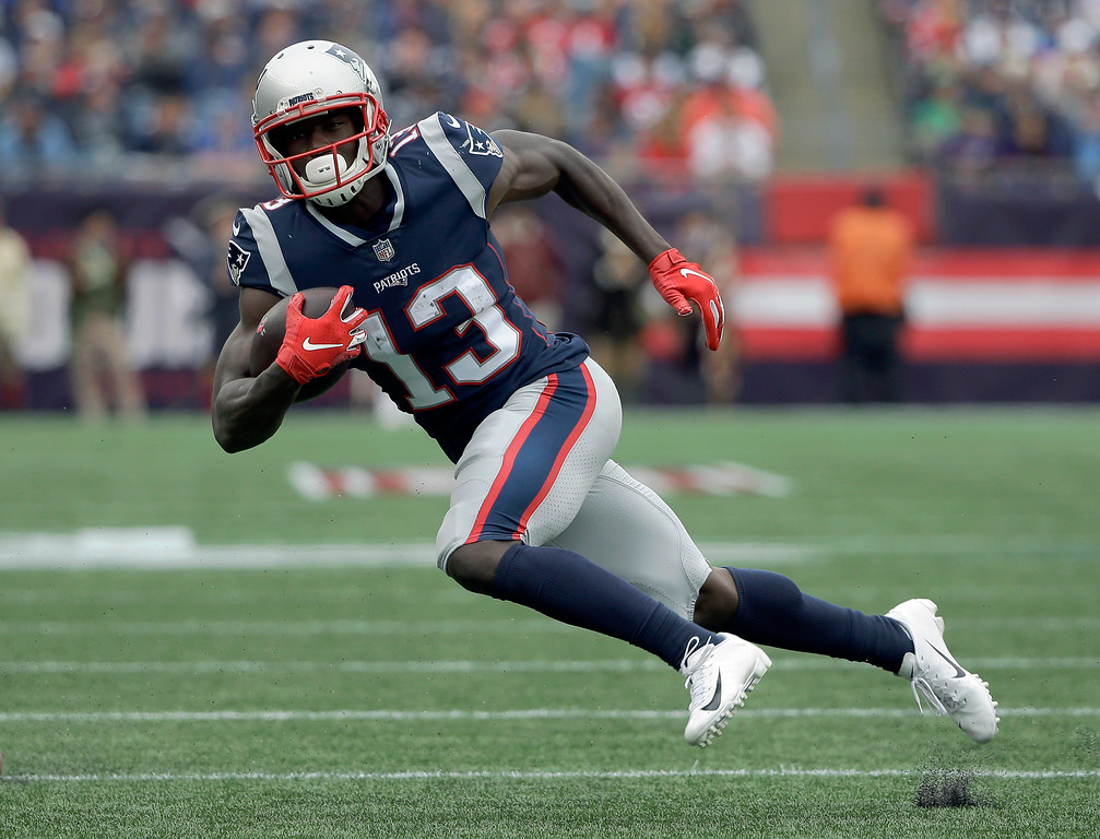 . New England Patriots wide receiver Phillip Dorsett runs after catching a pass against the Houston Texans during the second half of an NFL football game, Sunday, Sept. 9, 2018, in Foxborough, Mass. (AP Photo/Steven Senne)