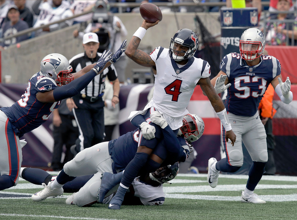 . New England Patriots defensive tackle Malcom Brown wraps up Houston Texans quarterback Deshaun Watson (4) as he tries to pass during the first half of an NFL football game, Sunday, Sept. 9, 2018, in Foxborough, Mass. (AP Photo/Charles Krupa)