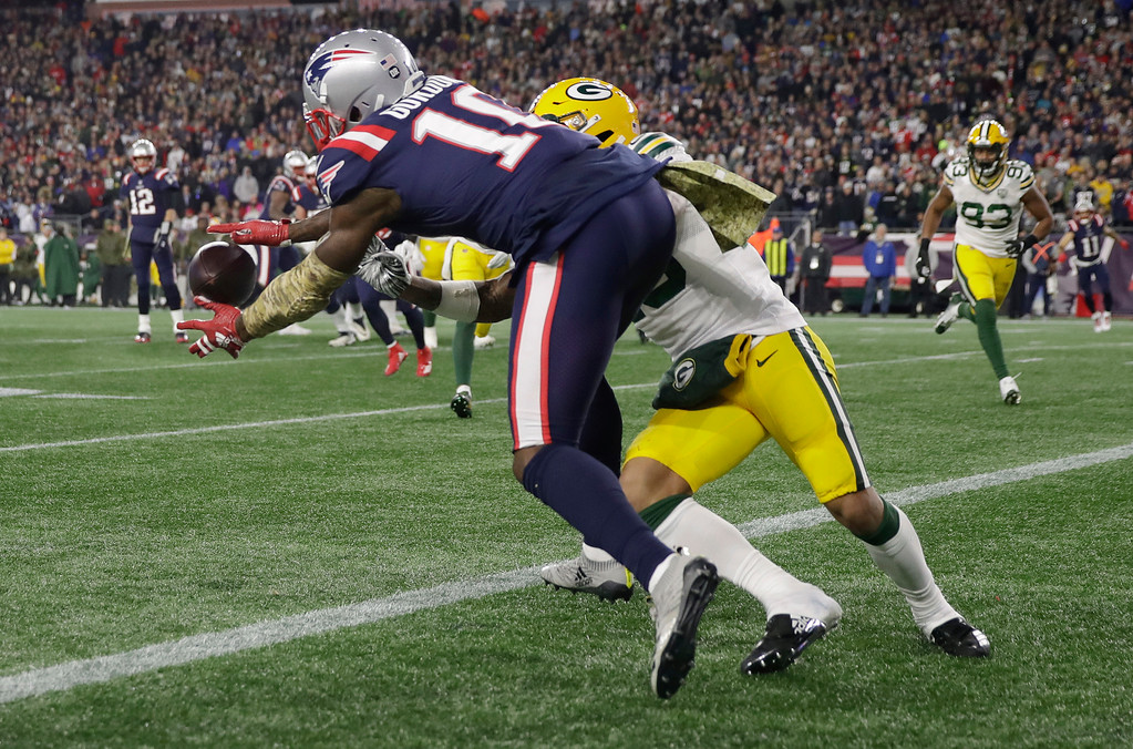 . New England Patriots wide receiver Josh Gordon (10) can\'t catch a pass in the end zone as Green Bay Packers cornerback Jaire Alexander, right, defends during the second half of an NFL football game, Sunday, Nov. 4, 2018, in Foxborough, Mass. (AP Photo/Charles Krupa)