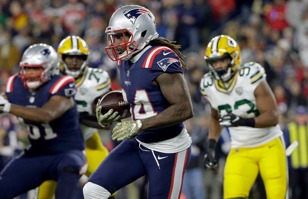 . New England Patriots wide receiver Cordarrelle Patterson (84) runs from Green Bay Packers linebacker Reggie Gilbert (93) during the first half of an NFL football game, Sunday, Nov. 4, 2018, in Foxborough, Mass. (AP Photo/Steven Senne)