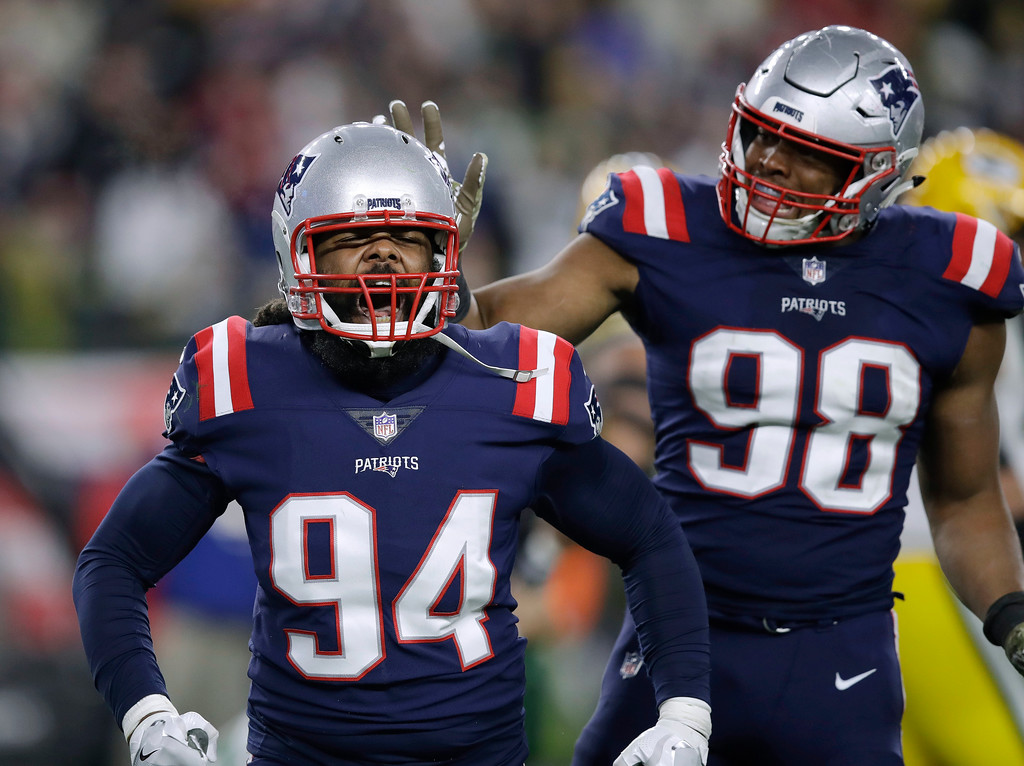 . New England Patriots defensive ends Adrian Clayborn (94) and Trey Flowers (98) celebrate their sack of Green Bay Packers quarterback Aaron Rodgers during the second half of an NFL football game, Sunday, Nov. 4, 2018, in Foxborough, Mass. (AP Photo/Charles Krupa)