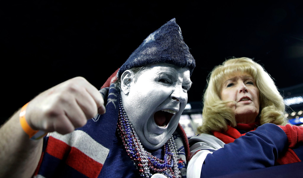 . New England Patriots fans get fired up as the team warms up before an NFL football game against the Green Bay Packers, Sunday, Nov. 4, 2018, in Foxborough, Mass. (AP Photo/Charles Krupa)