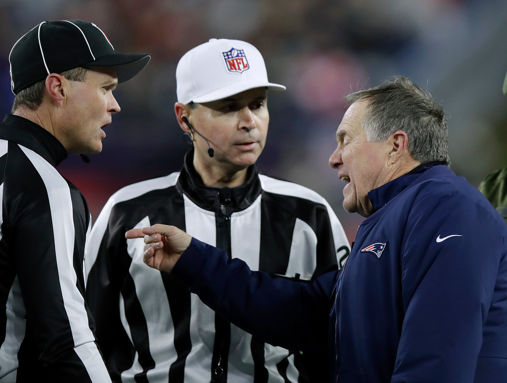 . New England Patriots head coach Bill Belichick, right, argues a point with line judge Brian Bolinger, left, and referee Brad Allen during the first half of an NFL football game against the Green Bay Packers, Sunday, Nov. 4, 2018, in Foxborough, Mass. (AP Photo/Charles Krupa)