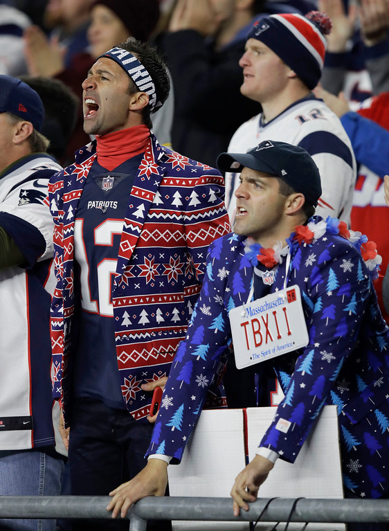 . New England Patriots fans watch during the first half of an NFL football game between the Patriots and the Green Bay Packers, Sunday, Nov. 4, 2018, in Foxborough, Mass. (AP Photo/Charles Krupa)