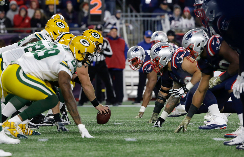 . The Green Bay Packers and the New England Patriots face off at the line of scrimmage during the second half of an NFL football game, Sunday, Nov. 4, 2018, in Foxborough, Mass. (AP Photo/Steven Senne)