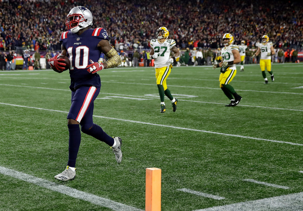 . New England Patriots wide receiver Josh Gordon (10) runs for a touchdown after catching a pass during the second half of an NFL football game against the Green Bay Packers, Sunday, Nov. 4, 2018, in Foxborough, Mass. (AP Photo/Charles Krupa)