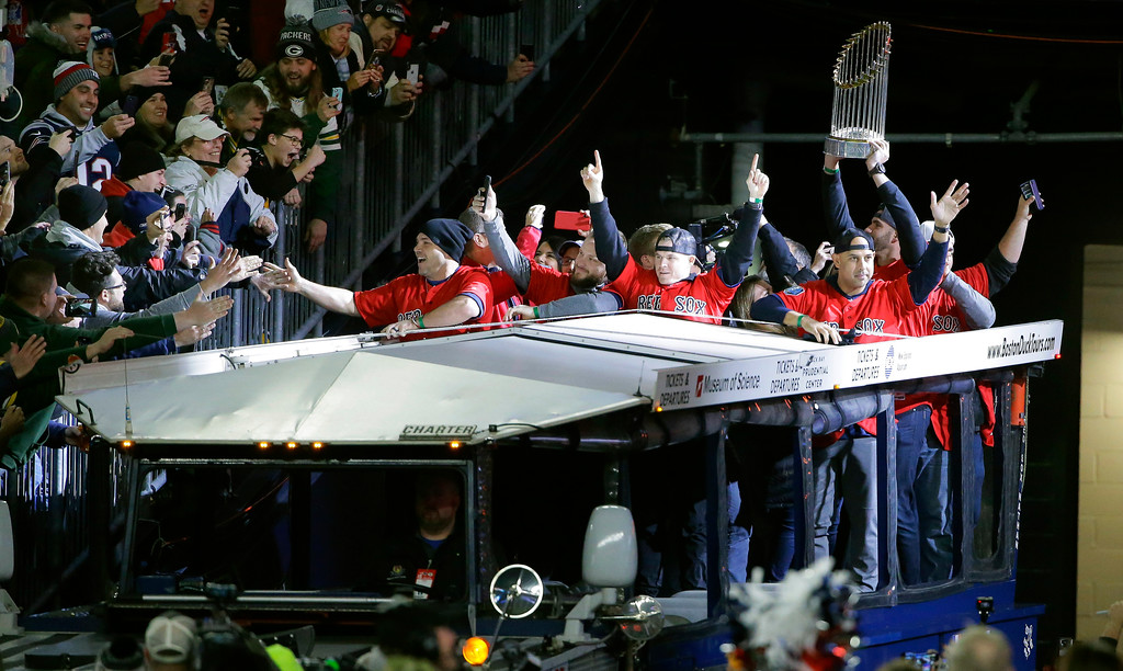 . World Series champion Boston Red Sox players ride onto the field in a duckboat before an NFL football game between the New England Patriots and the Green Bay Packers, Sunday, Nov. 4, 2018, in Foxborough, Mass. (AP Photo/Steven Senne)