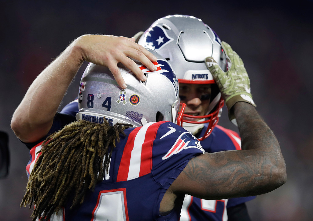 . New England Patriots wide receiver Cordarrelle Patterson, left, celebrates his touchdown run with quarterback Tom Brady during the first half of an NFL football game against the Green Bay Packers, Sunday, Nov. 4, 2018, in Foxborough, Mass. (AP Photo/Charles Krupa)