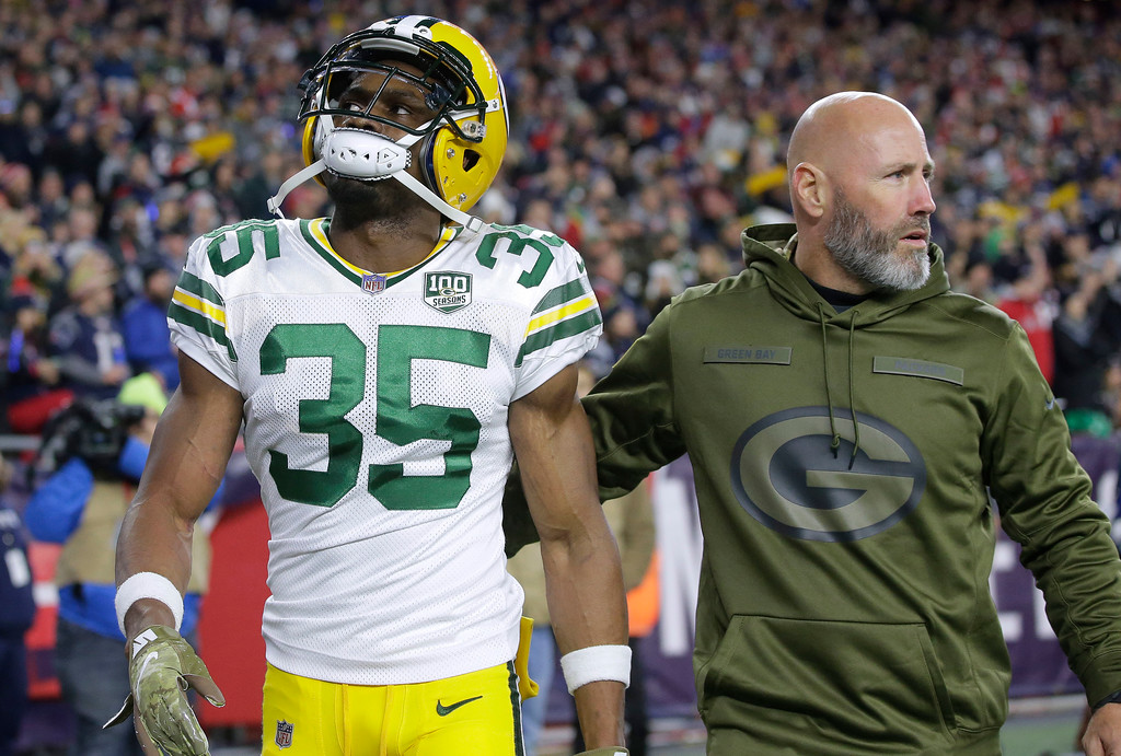 . Green Bay Packers defensive back Jermaine Whitehead, left, is escorted from the field after being ejected during the first half of an NFL football game against the New England Patriots, Sunday, Nov. 4, 2018, in Foxborough, Mass. (AP Photo/Steven Senne)