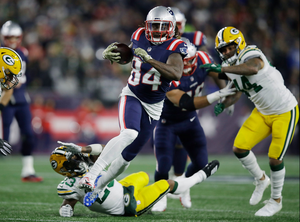 . New England Patriots wide receiver Cordarrelle Patterson (84) gains yardage as a running back during the first half of an NFL football game against the Green Bay Packers, Sunday, Nov. 4, 2018, in Foxborough, Mass. (AP Photo/Charles Krupa)