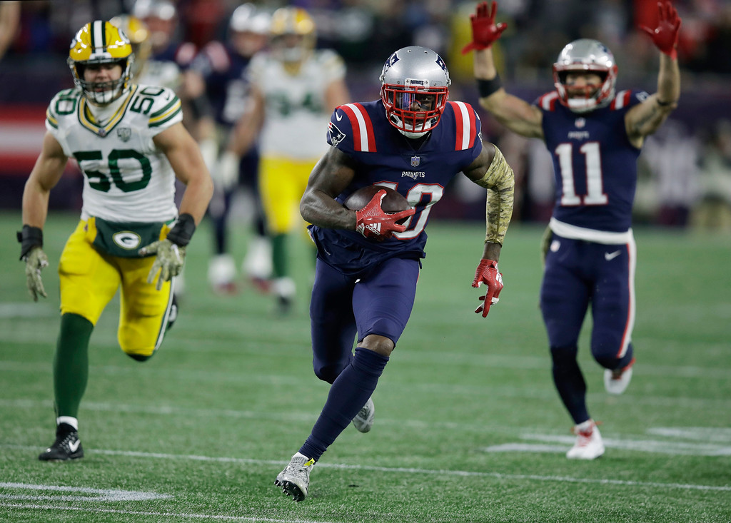 . New England Patriots wide receiver Josh Gordon (10) runs from Green Bay Packers linebacker Blake Martinez (50) for a touchdown after catching a pass during the second half of an NFL football game, Sunday, Nov. 4, 2018, in Foxborough, Mass. (AP Photo/Charles Krupa)