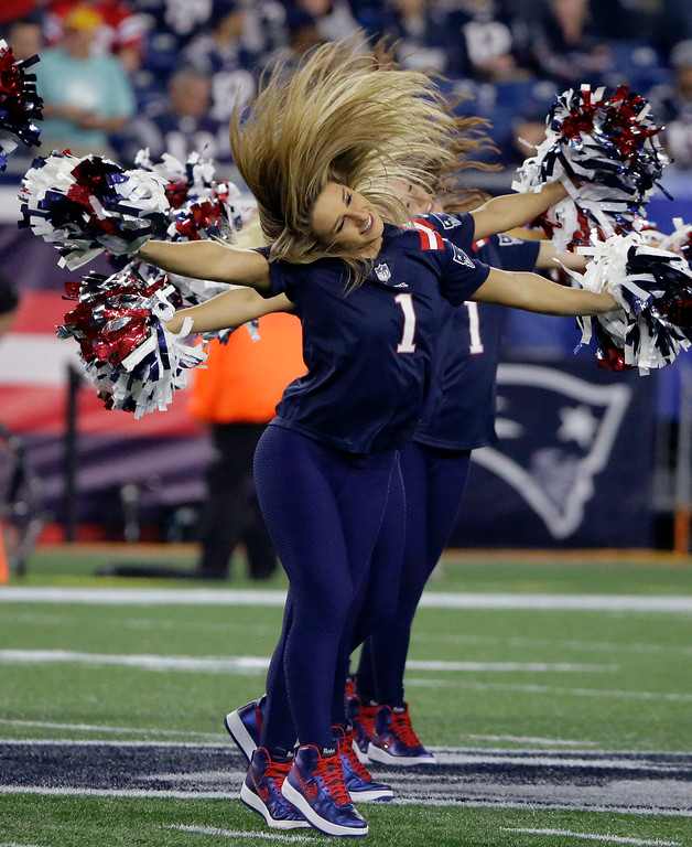 . New England Patriots cheerleaders perform before an NFL football game between the Patriots and the Indianapolis Colts, Thursday, Oct. 4, 2018, in Foxborough, Mass. (AP Photo/Steven Senne)