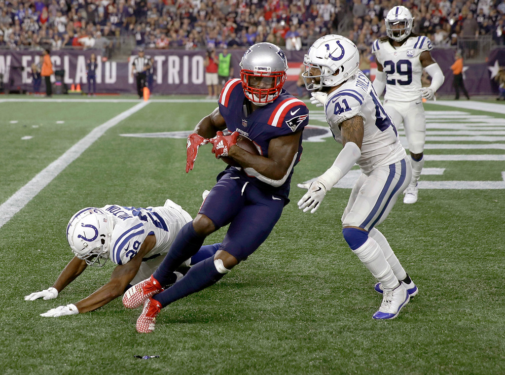 . New England Patriots wide receiver Josh Gordon, makes a touchdown catch in front of Indianapolis Colts defensive back Matthias Farley (41) during the second half of an NFL football game, Thursday, Oct. 4, 2018, in Foxborough, Mass. (AP Photo/Charles Krupa)