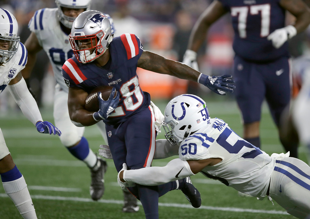 . Indianapolis Colts linebacker Anthony Walker (50) tackles New England Patriots running back James White (28) during the first half of an NFL football game, Thursday, Oct. 4, 2018, in Foxborough, Mass. (AP Photo/Charles Krupa)