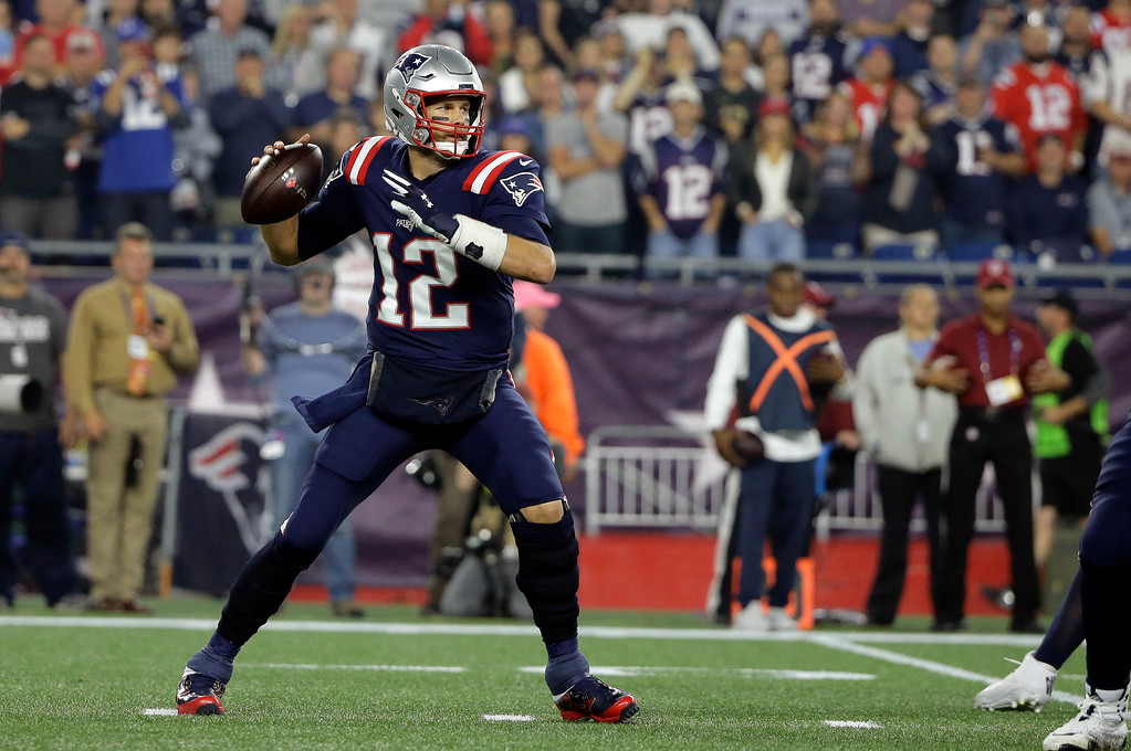 . New England Patriots quarterback Tom Brady passes against the Indianapolis Colts during the first half of an NFL football game, Thursday, Oct. 4, 2018, in Foxborough, Mass. (AP Photo/Steven Senne)