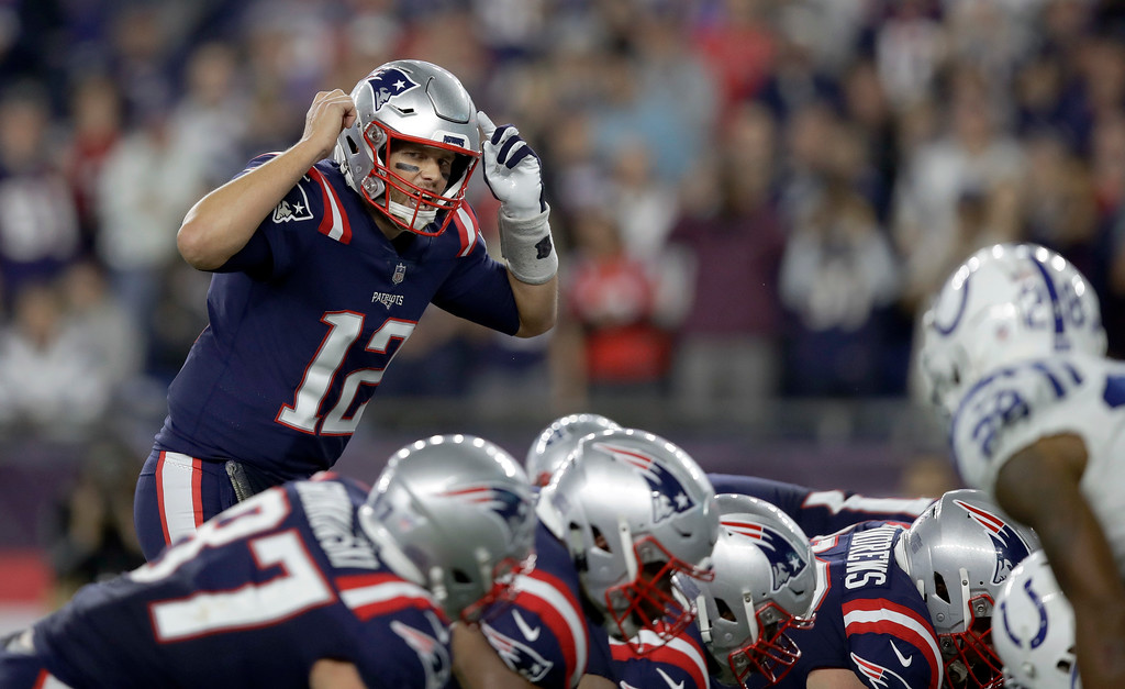 . New England Patriots quarterback Tom Brady calls signals at the line of scrimmage during the first half of an NFL football game against the Indianapolis Colts, Thursday, Oct. 4, 2018, in Foxborough, Mass. (AP Photo/Charles Krupa)