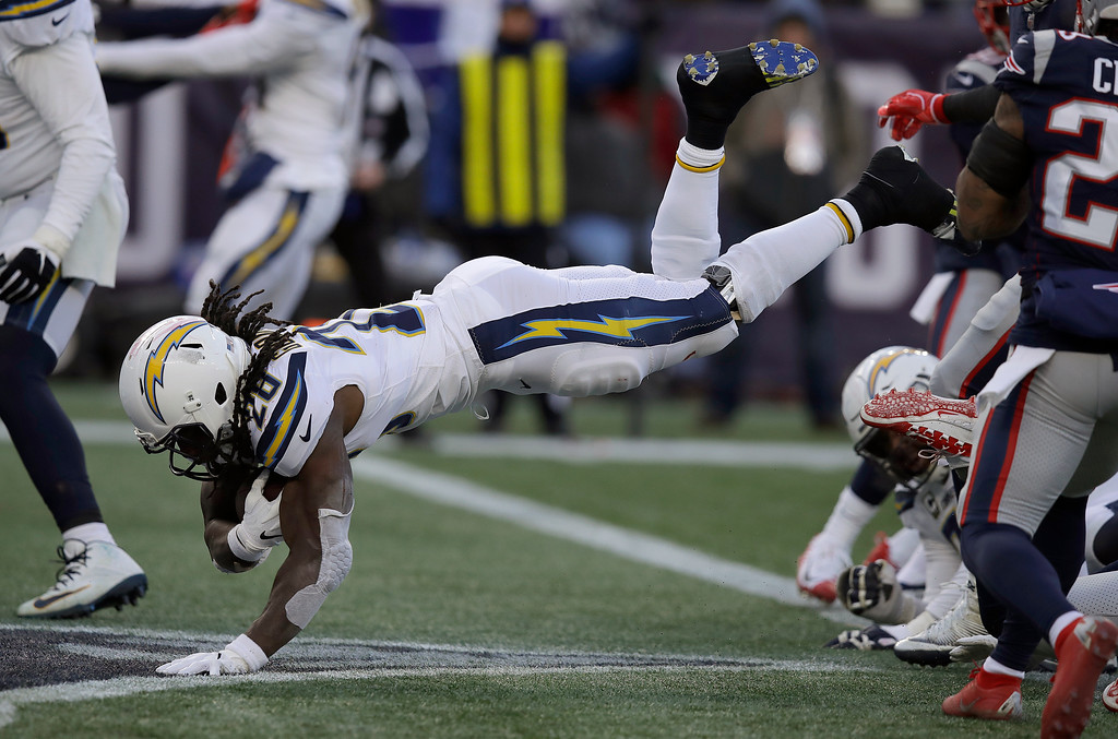 . Los Angeles Chargers running back Melvin Gordon dives into the end zone for a touchdown during the second half of an NFL divisional playoff football game against the New England Patriots, Sunday, Jan. 13, 2019, in Foxborough, Mass. (AP Photo/Charles Krupa)