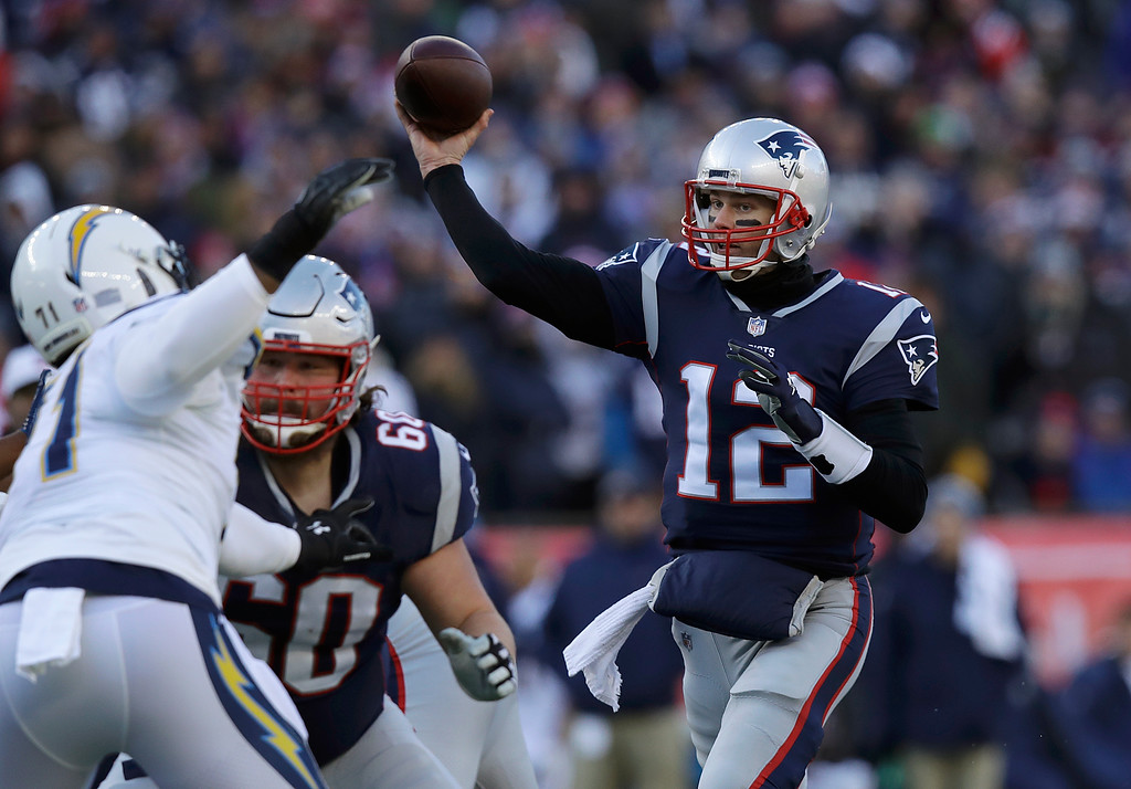 . New England Patriots quarterback Tom Brady (12) passes under pressure from Los Angeles Chargers defensive end Damion Square (71) during the first half of an NFL divisional playoff football game, Sunday, Jan. 13, 2019, in Foxborough, Mass. (AP Photo/Charles Krupa)
