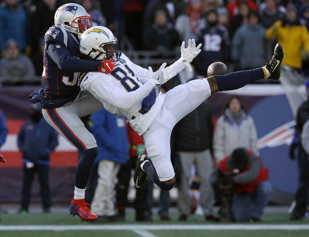 . New England Patriots defensive back Devin McCourty, left, breaks up a pass intended for Los Angeles Chargers wide receiver Mike Williams during the first half of an NFL divisional playoff football game, Sunday, Jan. 13, 2019, in Foxborough, Mass. (AP Photo/Charles Krupa)