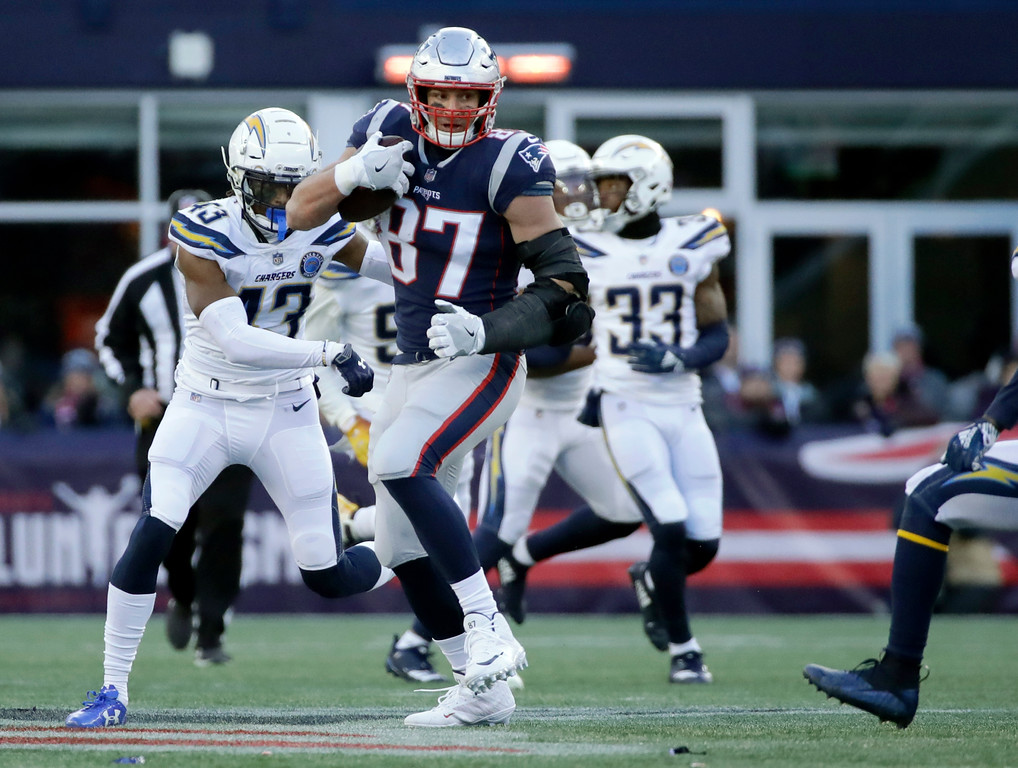 . New England Patriots tight end Rob Gronkowski (87) runs after catching a pass during the second half of an NFL divisional playoff football game against the Los Angeles Chargers, Sunday, Jan. 13, 2019, in Foxborough, Mass. (AP Photo/Elise Amendola)
