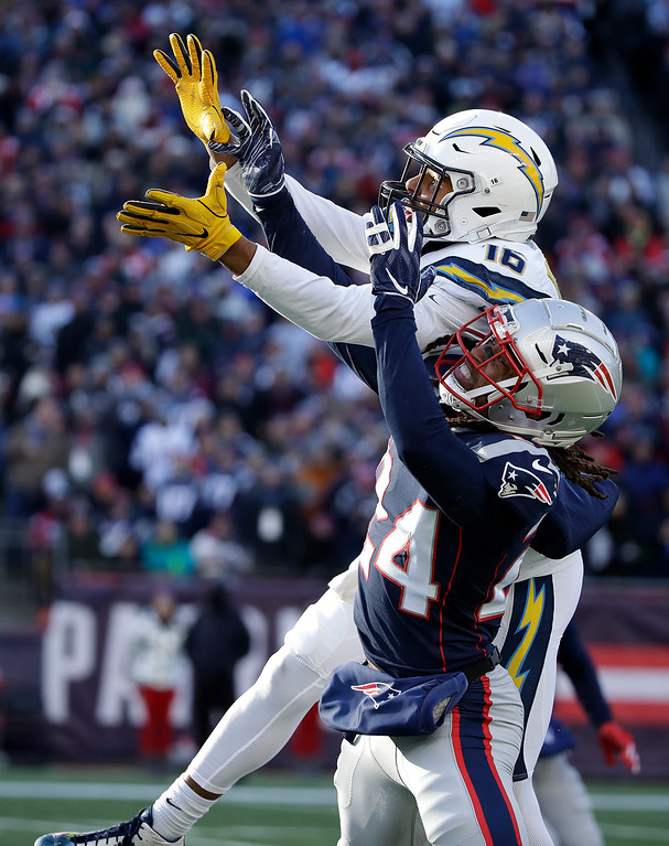 . Los Angeles Chargers wide receiver Tyrell Williams (16) reaches for a pass as New England Patriots defensive back Stephon Gilmore (24) defends during the first half of an NFL divisional playoff football game, Sunday, Jan. 13, 2019, in Foxborough, Mass. (AP Photo/Elise Amendola)