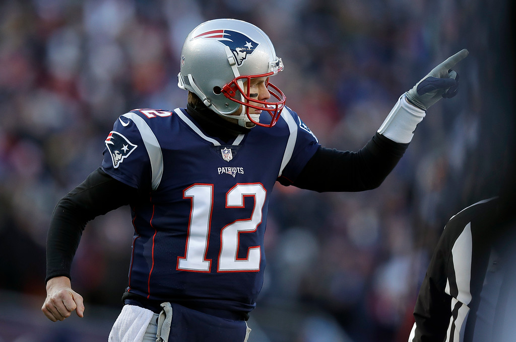 . New England Patriots quarterback Tom Brady celebrates one of his team\'s five first-half touchdowns against the Los Angeles Chargers during the first half of an NFL divisional playoff football game, Sunday, Jan. 13, 2019, in Foxborough, Mass. (AP Photo/Charles Krupa)