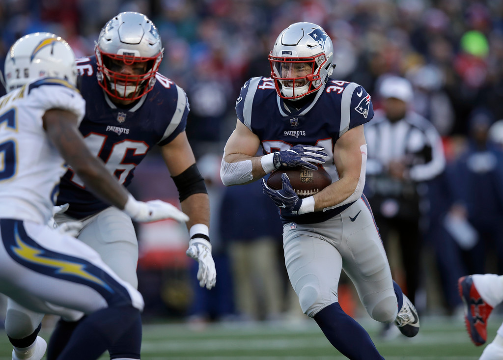 . New England Patriots running back Rex Burkhead runs toward the goal line for a touchdown against the Los Angeles Chargers during the first half of an NFL divisional playoff football game, Sunday, Jan. 13, 2019, in Foxborough, Mass. (AP Photo/Charles Krupa)