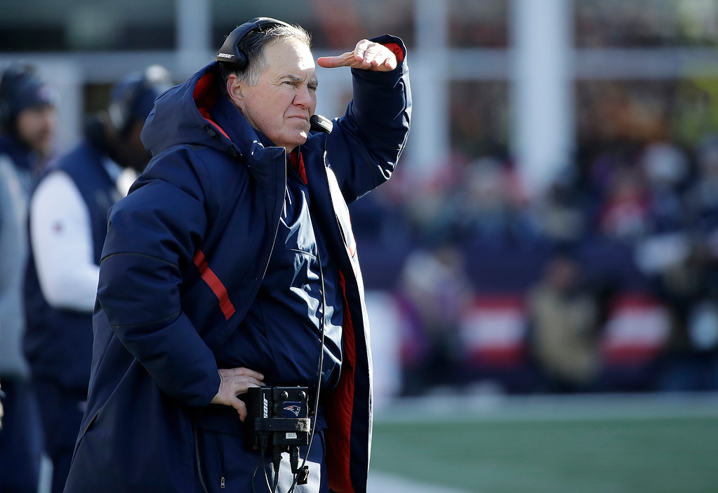 . New England Patriots head coach Bill Belichick watches from the sideline during the first half of an NFL divisional playoff football game against the Los Angeles Chargers, Sunday, Jan. 13, 2019, in Foxborough, Mass. (AP Photo/Elise Amendola)