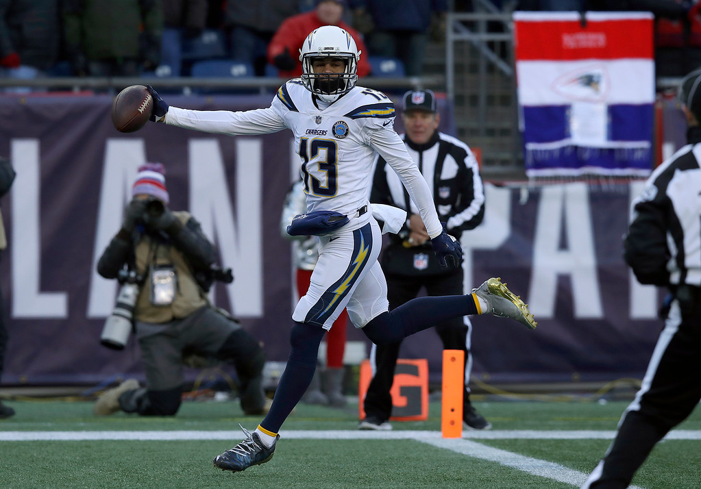 . Los Angeles Chargers wide receiver Keenan Allen scores a touchdown against the New England Patriots during the first half of an NFL divisional playoff football game, Sunday, Jan. 13, 2019, in Foxborough, Mass. (AP Photo/Charles Krupa)