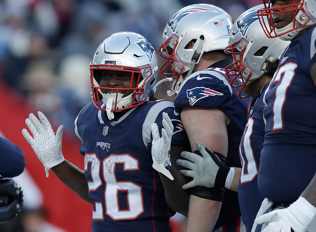 . New England Patriots running back Sony Michel (26) celebrates his third touchdown against the Los Angeles Chargers during the first half of an NFL divisional playoff football game, Sunday, Jan. 13, 2019, in Foxborough, Mass. (AP Photo/Charles Krupa)