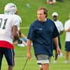 Randy Moss, #81; head coach Bill Belichick.