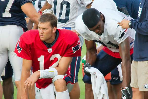 Tom Brady, #12; Randy Moss, #81