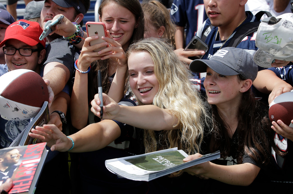 . Fans call out to New England Patriots football players asking for autographs following an NFL football practice, Thursday, July 26, 2018, in Foxborough, Mass. (AP Photo/Steven Senne)