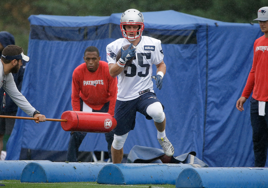 . New England Patriots wide receiver Braxton Berrios (55) performs agility drills during NFL football practice, Thursday, July 26, 2018, in Foxborough, Mass. (AP Photo/Steven Senne)