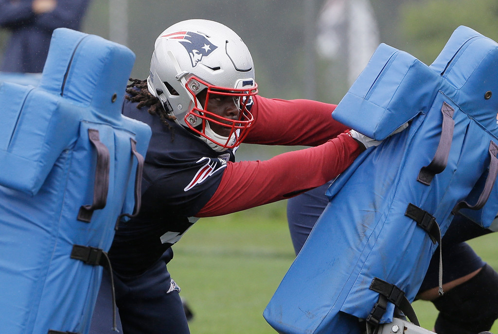 . New England Patriots defensive tackle Malcom Brown performs drills during NFL football practice, Thursday, July 26, 2018, in Foxborough, Mass. (AP Photo/Steven Senne)