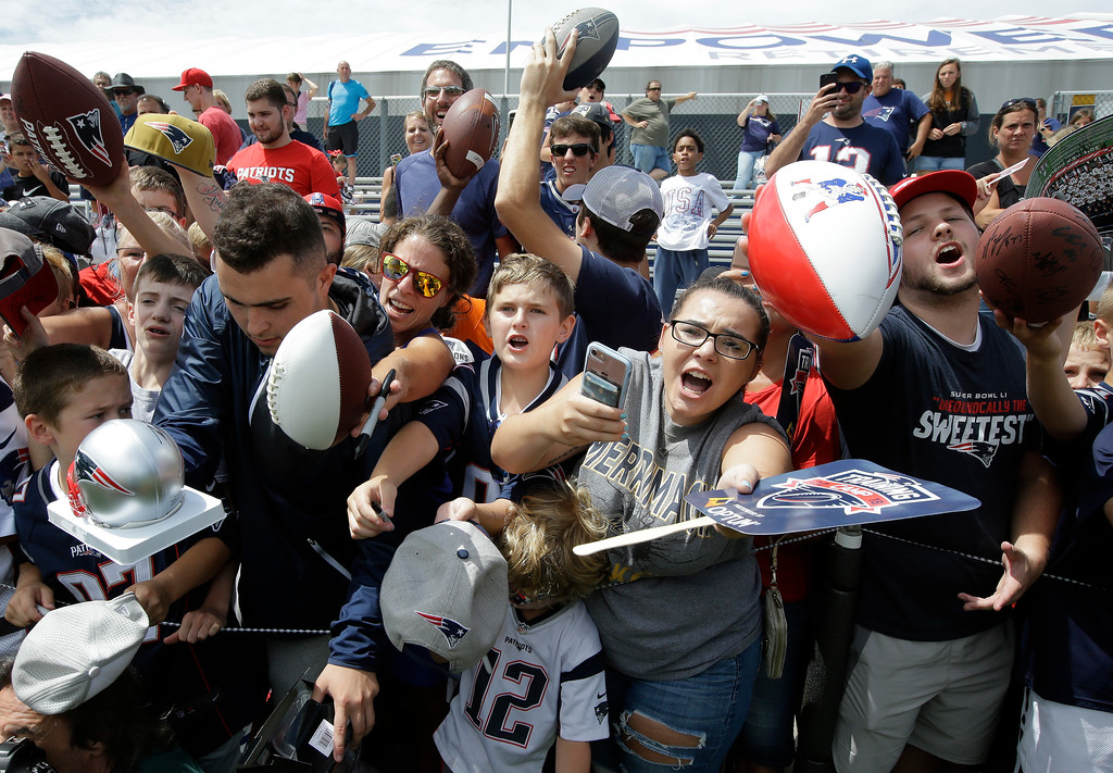 . Fans call out to New England Patriots wide receiver Julian Edelman, not shown, asking for autographs following NFL football practice, Thursday, July 26, 2018, in Foxborough, Mass. (AP Photo/Steven Senne)