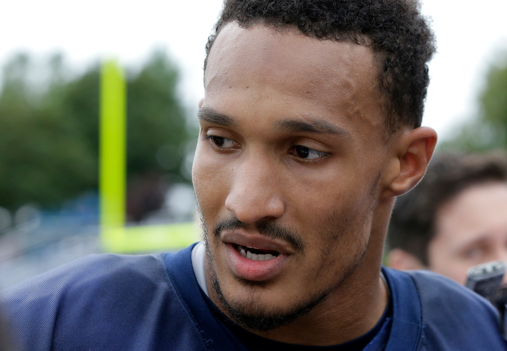 . New England Patriots defensive end Derek Rivers (95) speaks with reporters at NFL football training camp, Thursday, July 27, 2017, in Foxborough, Mass. (AP Photo/Steven Senne)